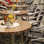 Image of empty chairs and tables in an outdoor restaurant